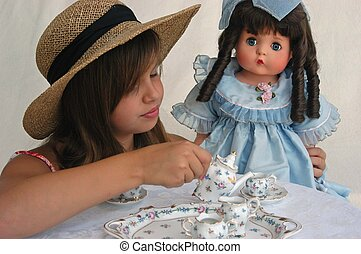 tea party - young girl playing tea party with doll