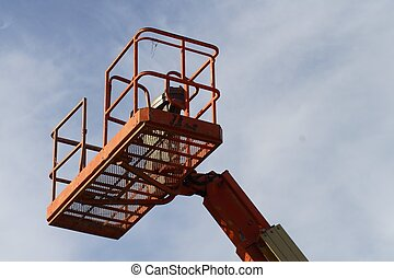 Cherry Picker - Orange cherry picker crane against a blue...