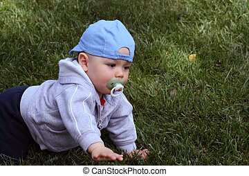 Crawling Baby - Baby, with a pacifier in his mouth, crawling