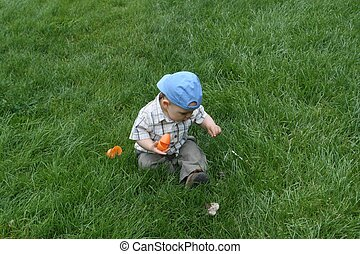 Easter Egg Hunt - Baby at his first Easter egg hunt, finding...