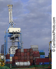 Freighting - Detail of crane over stacked containers in...