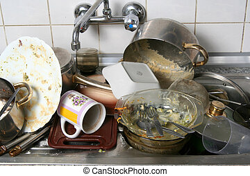 Dish washing - Pile of dirty dishes in the metal sink