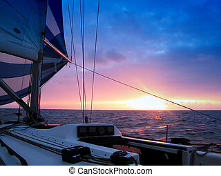 sailing at dusk - sailing in the Atlantic at dusk