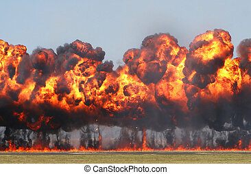 Giant Explosion A wall of fire explodes on an open field