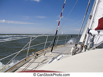 sailing - sailboat with blue sky on the background