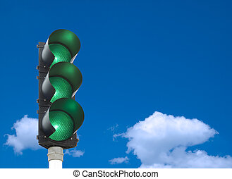 Traffic lights - all three lights are green in front of blue...