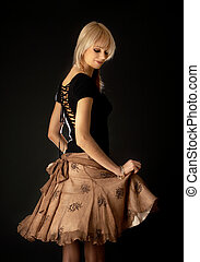 bailando, rubio, marrón, falda