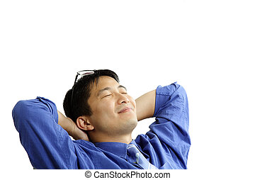 Relaxed businessman - A businessman relaxing comfortably at...