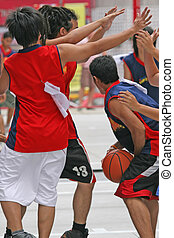 Basketball Game - Students taking part in a game of...