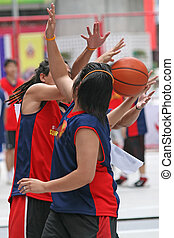 Basketball Match - Game of basketball involving teenagers