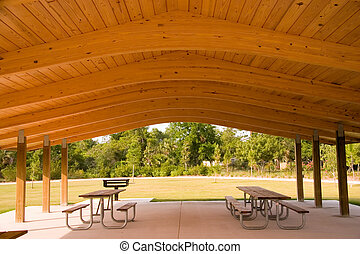 Picnic area - Picnic tables and grill under wood roof...