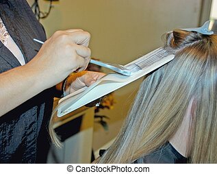 highlighting hair - women having her hair highlighted