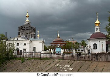 Domes of orthodox temple against the background of the cloud...
