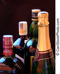 Beverages - Wine, whiskey, and Champagne bottles together