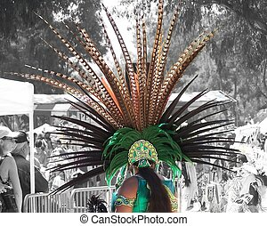 Aztec Maiden - A young woman in traditional Aztec costume at...
