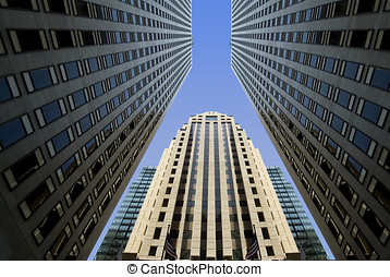 big business - looking up at the sky, surrounded by tall...