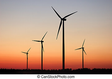 Windturbines against dramatic sunset