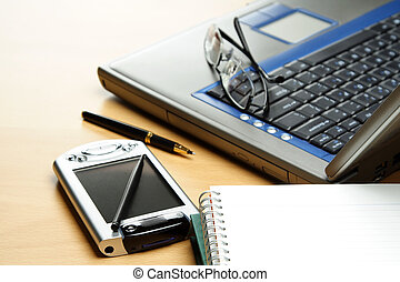 Business environment - A PDA, notebook and laptop in a...