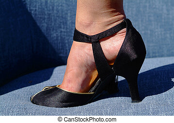 high heeled shoe - women foot in black golden high heeled...