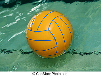 Water polo ball - Yellow water polo ball rests in a of blue...