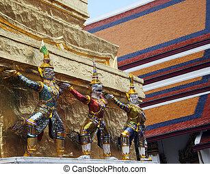 Statues at the Grand Palace, Bangkok, Thailand.