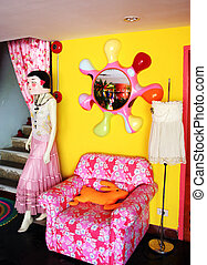 Funky retro interior with chair and mannequin - EDITORIAL...