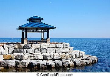 Gazebo On The Lake - Blue gazebo on a bright blue lake
