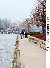 Biking On A Path - Biking on a path near a lake on a foggy...