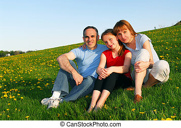 Family portrait - Portrait of a happy family of three on...