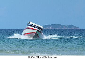 Speedboat at sea - Red and white speedboat turning towards...
