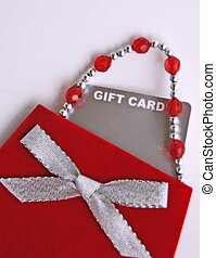 gift card in small red purse