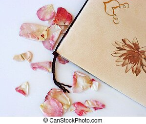 card and rose petals
