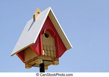 Birdhouse - A new birdhouse on top of a pole on clear...