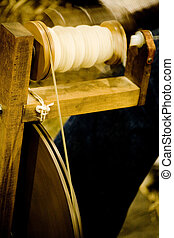 antique spinning machine close up