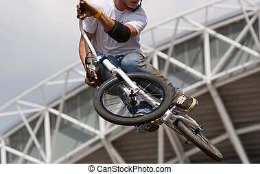 biker Airborne - A Bicycle Moto-crossX in the air against an...