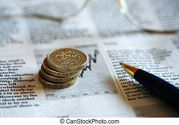 Business GBP coins, glasses and pen - A pile of four GBP...