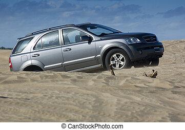 Fun on the Beach - A four-wheel-drive drives through the...