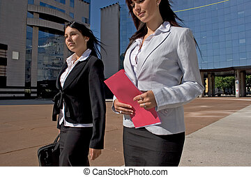 Businesswoman - two young people businesswoman going town...