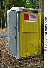 porta potty - an image of a porta potty in the woods
