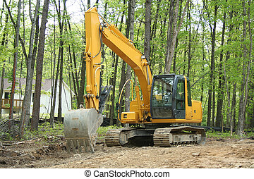 Backhoe - an image of a backhoe in the woods