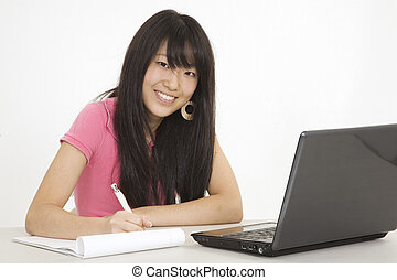 382 Teens - Asian teenager working on a the laptop computer...