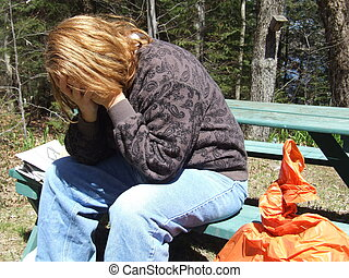 Homeless Woman - Woman sitting on a park bench
