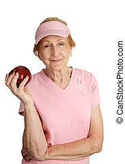 Healthy Snack - A senior woman dressed in pink for breast...