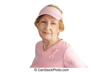Breast Cancer Awareness - A senior woman dressed in pink and...