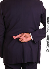 Crossed fingers behind back - Businessman in dark suit with...