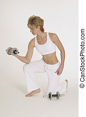 Woman working with dumbells - MR 267 Woman in mid 20s...