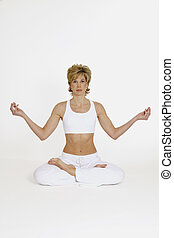 Woman performing Yoga - MR 267 Woman in mid 20s preforminf...