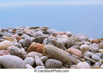 Beach pebbles - Background of colofrul beach pebbles of...