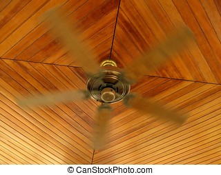 Rotating Ceiling Fan - -- mounted on a ceiling covered in...