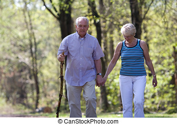 Senior couple walking - Senior couple out for a walk on a...